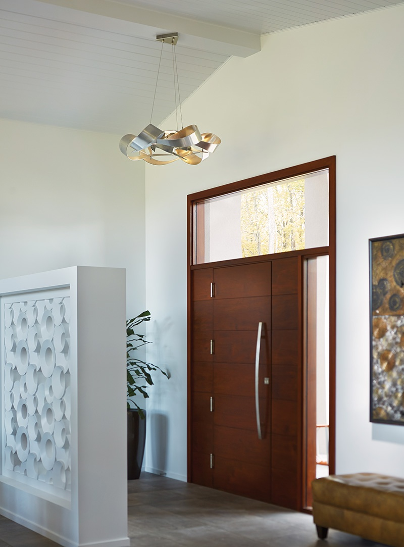 This Hubbardton Forge Pendant's size visually works in this foyer.