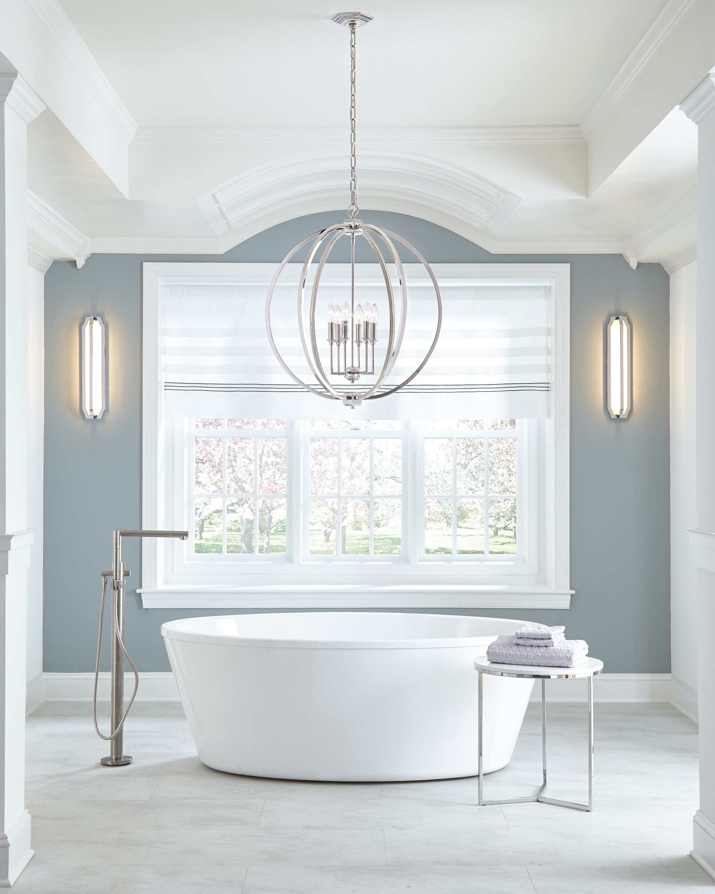 Feiss' Corinne Pendant sets the mood for this transitional master bathroom with the classy polished nickel finish and shimmering pave crystal.