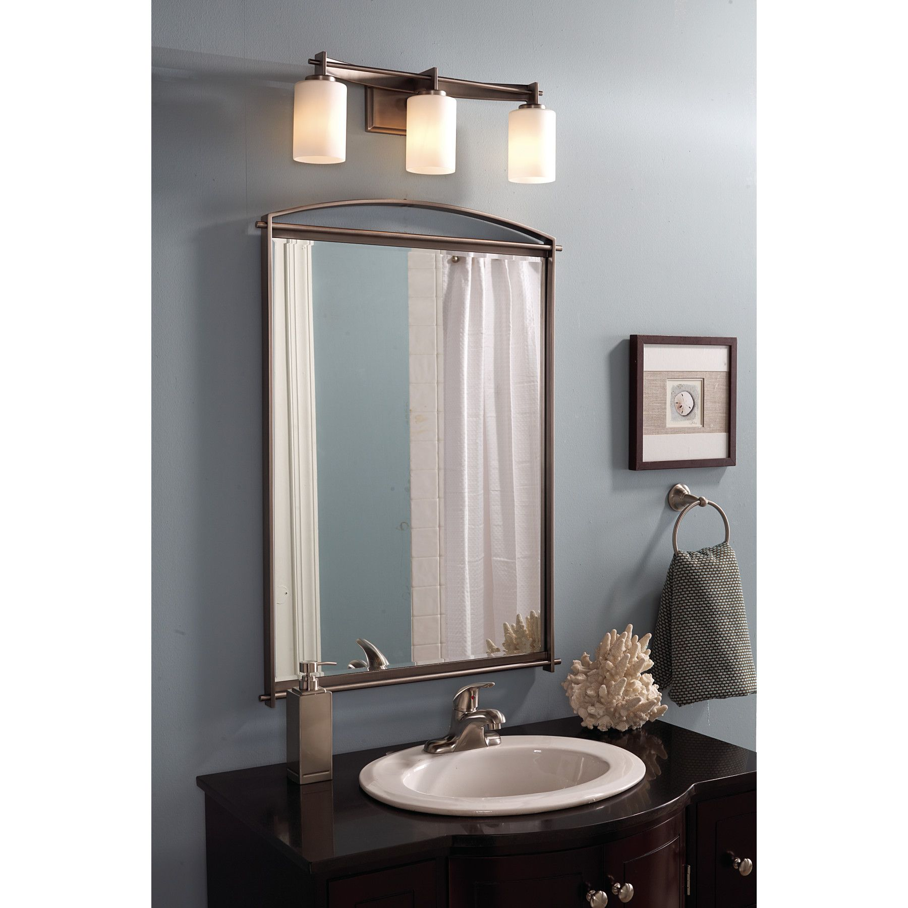 Quoizel's Taylor 3-Light Sconce provides plenty of light above a vanity. We love the contemporary lines of this sconce!