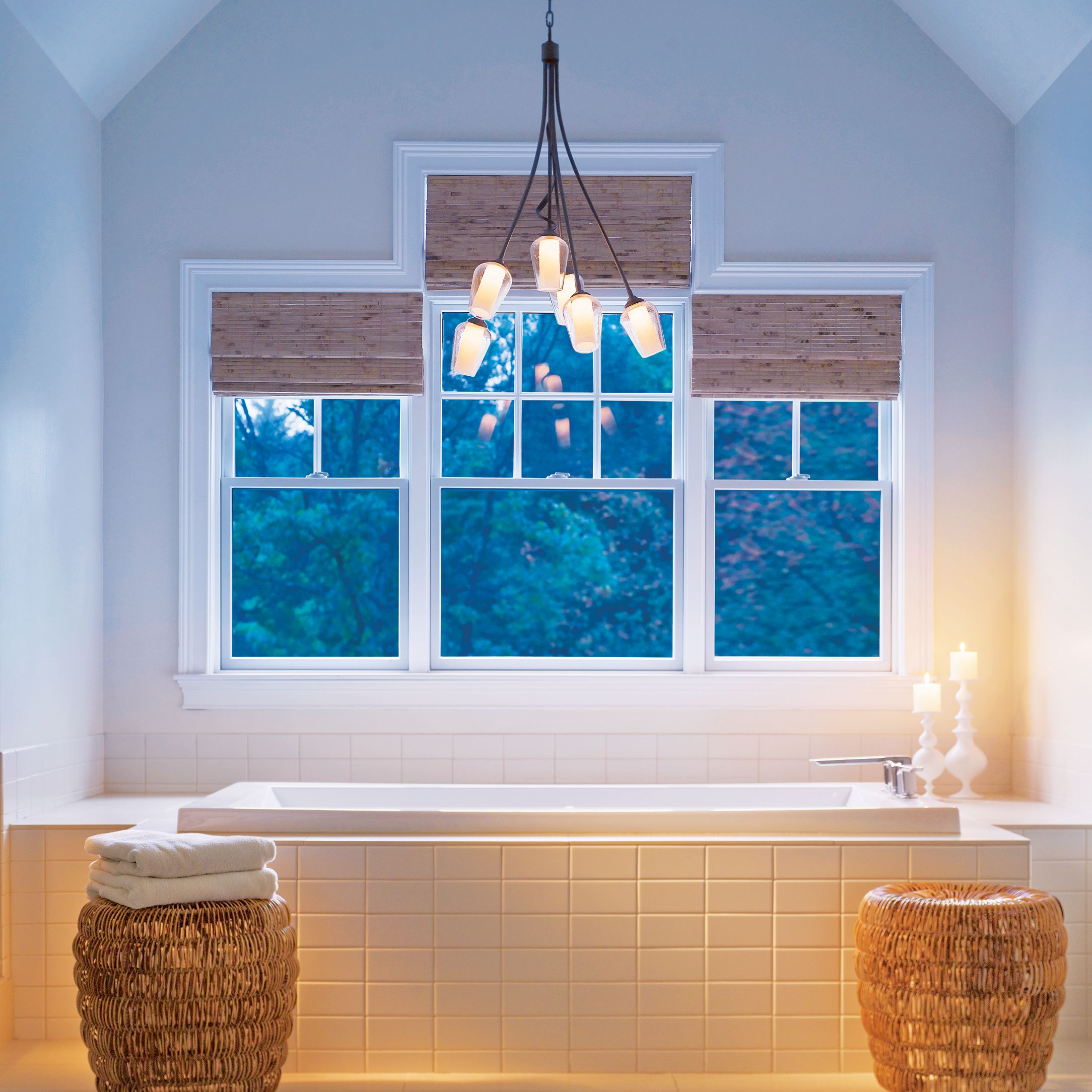 Hubbardton Forge's Flora 6-Light Chandelier creates the perfect atmosphere for a relaxing soak in the bathtub.