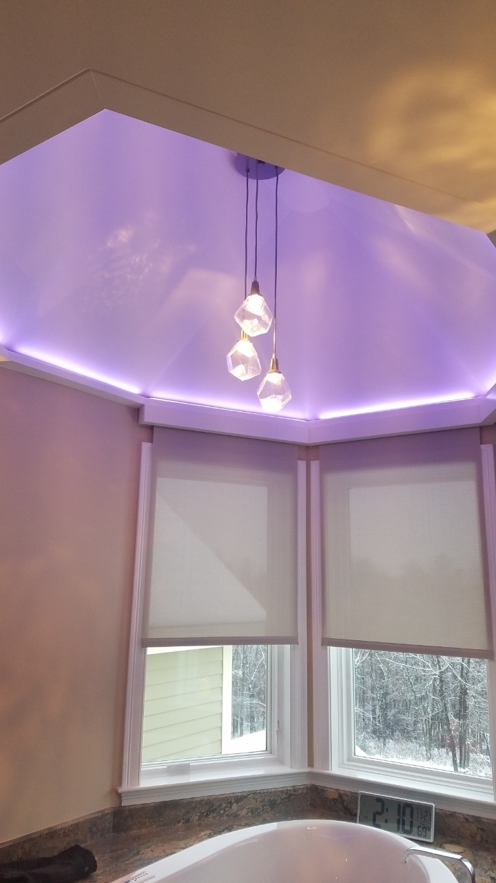Luminii's RGBW LED strip can be tuned to nearly any shade of the rainbow, including the soft purple shown here that plays beautifully with the Hammerton Studio Gem Chandelier.