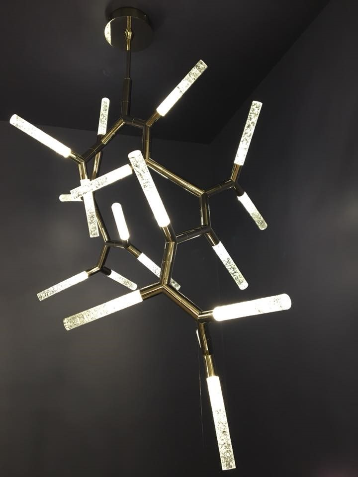 The acrylic diffusers on this Modern Forms chandelier refract light in a dazzling way.