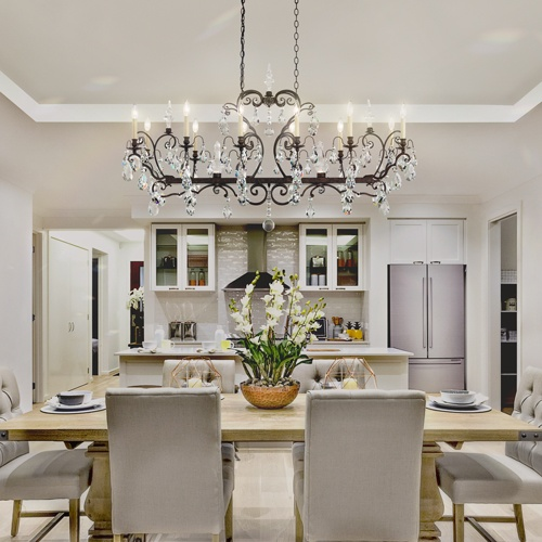 Schonbek's Renaissance Rectangle Chandelier is a beautiful addition to a dining room.