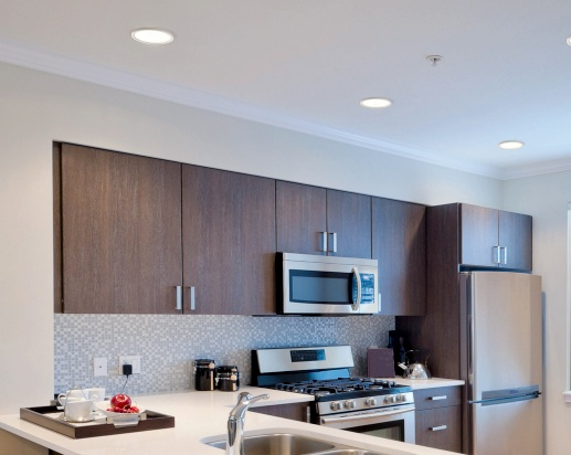 Recessed lighting can function as a type of ambient lighting in the kitchen.