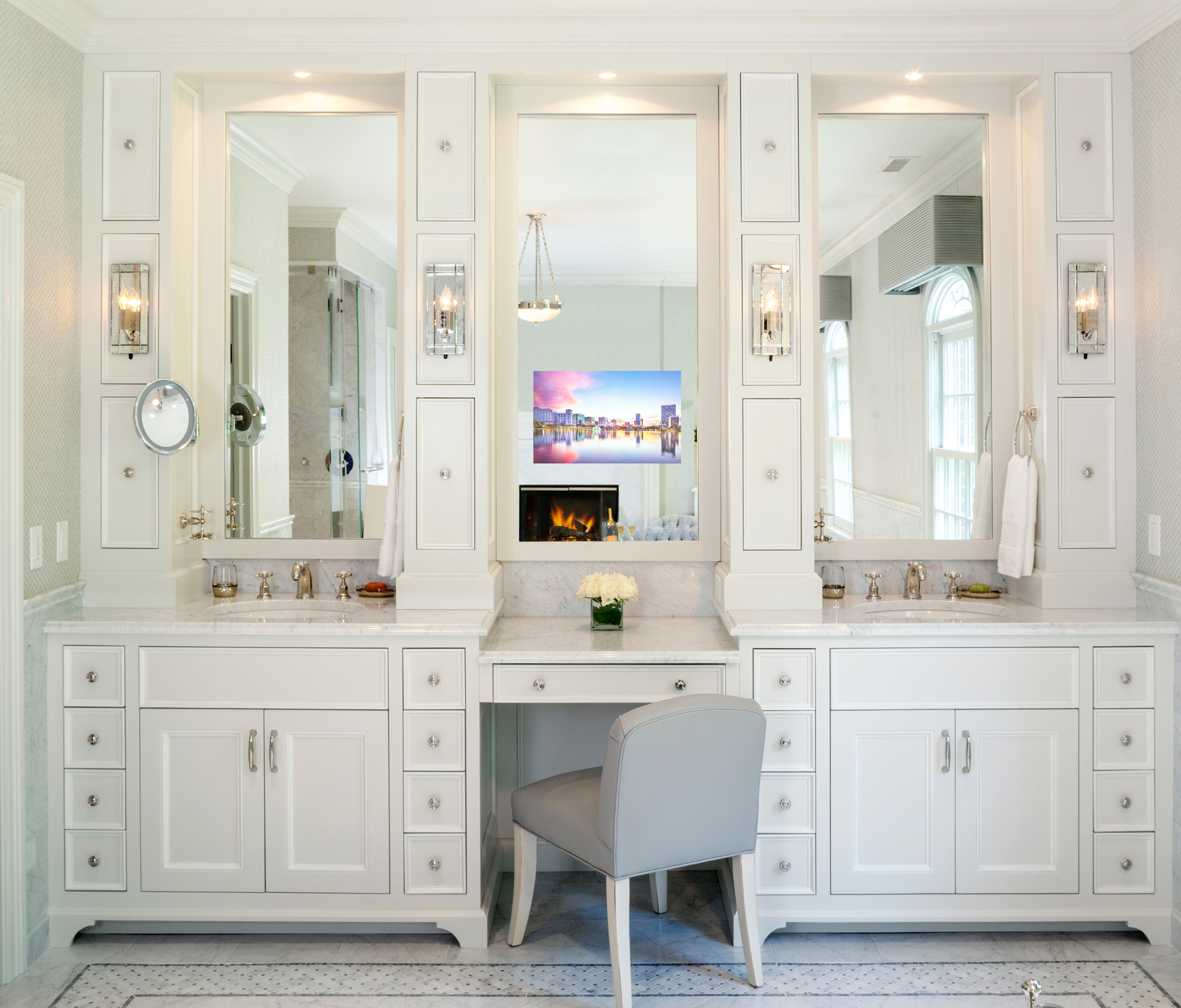 This classic master bathroom features a Seura TV mirror with Vanishing Vanity Glass in the center of a long vanity.